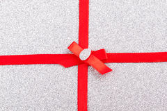 Red gift ribbon- bow. Backgrounds Royalty Free Stock Photography