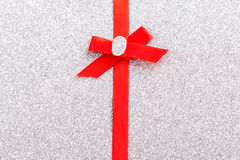 Red gift ribbon- bow. Backgrounds Stock Photo