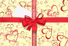 Red gift ribbon with a bow and hearts on yellow. Red gift ribbon with a bow on yellow background with hearts and white card Stock Image