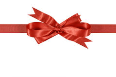 Red gift ribbon and bow horizontal isolated on white background. Horizontal red gift ribbon and bow isolated on a white background. Space for copy stock photo