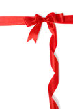 Red gift ribbon and bow isolated over white Royalty Free Stock Photos