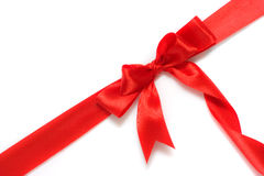 Red gift ribbon and bow isolated over white Royalty Free Stock Image