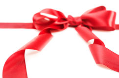 Red gift ribbon bow. Isolated on white background Royalty Free Stock Photography