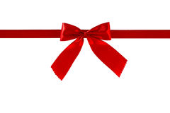 Red gift ribbon and bow, isolated on white background. Red gift ribbon and bow, isolated on white background , Clipping path included Royalty Free Stock Photography