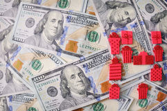 Red gift ribbon with bow over american dollars Royalty Free Stock Photo