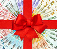 Red gift ribbon bow over euro banknotes. European currency. money background. shopping gift card concept Stock Photography