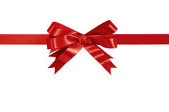Red gift ribbon bow straight horizontal isolated on white. Royalty Free Stock Photos