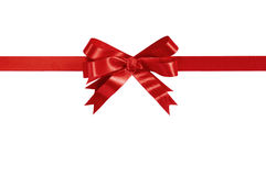 Red gift ribbon bow straight horizontal isolated on white. Stock Images
