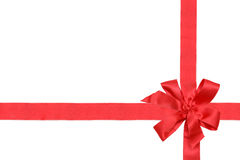Red gift ribbon and bow on white backgrou royalty free stock photos