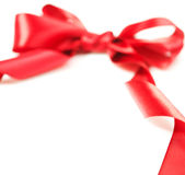 Red Gift Ribbon Bow. On white background Stock Photos