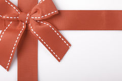 Red gift ribbon closeup. Red gift ribbon close up on white background Royalty Free Stock Photography