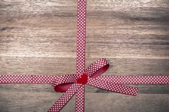 Red gift ribbon with hearts. Valentine`s day greeting card with empty space for text royalty free stock photography