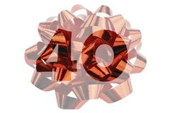 Red gift ribbon with the number 40 - symbolic for the 40th birthday or a forty-year anniversary. Isolated on white royalty free stock image