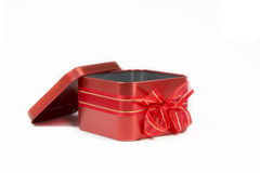 Red gift steel box with bow open cap on white background. Royalty Free Stock Photography
