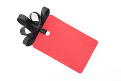 Red gift tag with black bow Stock Images