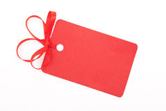 Red gift tag with bow. On white Stock Images