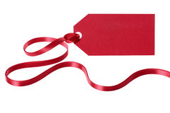 Red gift tag with long curly ribbon isolated on white background Stock Photo