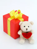 Red Gift and Teddy Bear. On white Royalty Free Stock Images