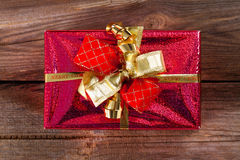 Red gift on weathered wood Royalty Free Stock Image