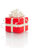 Red gift with white bow on a white background Royalty Free Stock Photo