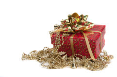 Red giftbox with golden bow. Giftbox wripped in red paper with golden bow isolated on white royalty free stock image