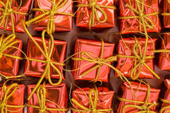 Red gifts. Many red gifts in orderliness Royalty Free Stock Image
