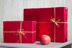 Red Gifts and apple. Photo serie with Red Gifts Stock Images