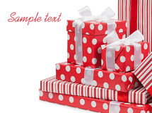 Red gifts boxes gifts tied with white bows ribbon isolated Royalty Free Stock Images