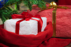 Red gifts with christmas tree royalty free stock images