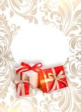 Red gifts on patterned background Stock Images