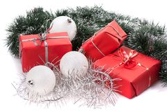 Red gifts with silver tinsel Royalty Free Stock Image