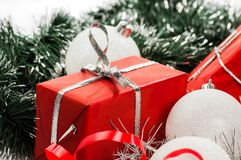 Red gifts with silver tinsel Royalty Free Stock Images
