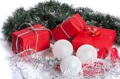 Red gifts with silver tinsel Stock Photos