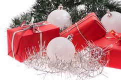 Red gifts with silver tinsel Stock Images