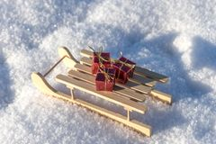 Red gifts on sled in the snow Stock Photos