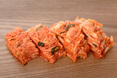 Red Gimchi on a wooden plate Stock Photo