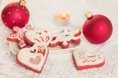 Red gingerbread cookies with christmas decoration Royalty Free Stock Image