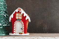 Red gingerbread house and christmas tree Stock Images