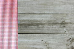 Red gingham border on wood background. Red gingham (checkered, plaid) border on wood background Stock Image