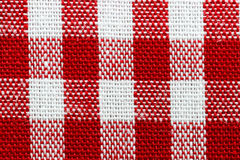 Red gingham fabric close up. Macro red and white gingham (checkered, plaid) fabric Royalty Free Stock Photos