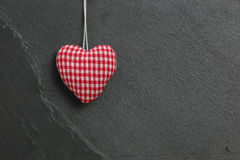 Red Gingham Love Valentine's heart hanging on grey slate stone b. Red Gingham Valentine's heart hanging on grey slate stone background, copy space Stock Photos