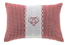 Red gingham pillow with flake of Swiss stone pine inside. Closeup of a red gingham pillow with flake of Swiss stone pine inside, decorated with hand-made vintage Royalty Free Stock Photography