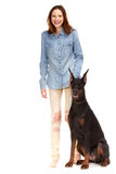Red girl in jeans with big dog Stock Photography