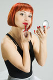 Red girl with lipstick and mirror Stock Photography