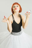 Red girl with lipstick and mirror Stock Images