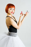 Red girl with lipstick and mirror Royalty Free Stock Photo