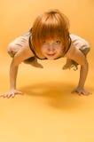 Red girl performing yoga asana Royalty Free Stock Photo