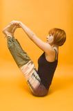 Red girl performing yoga asana Royalty Free Stock Photos
