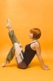 Red girl performing yoga asana Royalty Free Stock Images