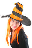 Red girl in striped black-orange hat Stock Photos